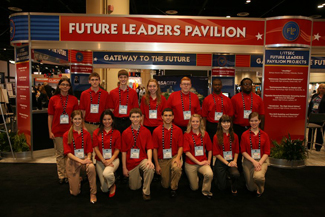 Group of people under Future Leaders Pavilion sign