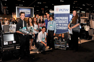 Students posing with project