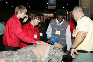Students examining medical dummy